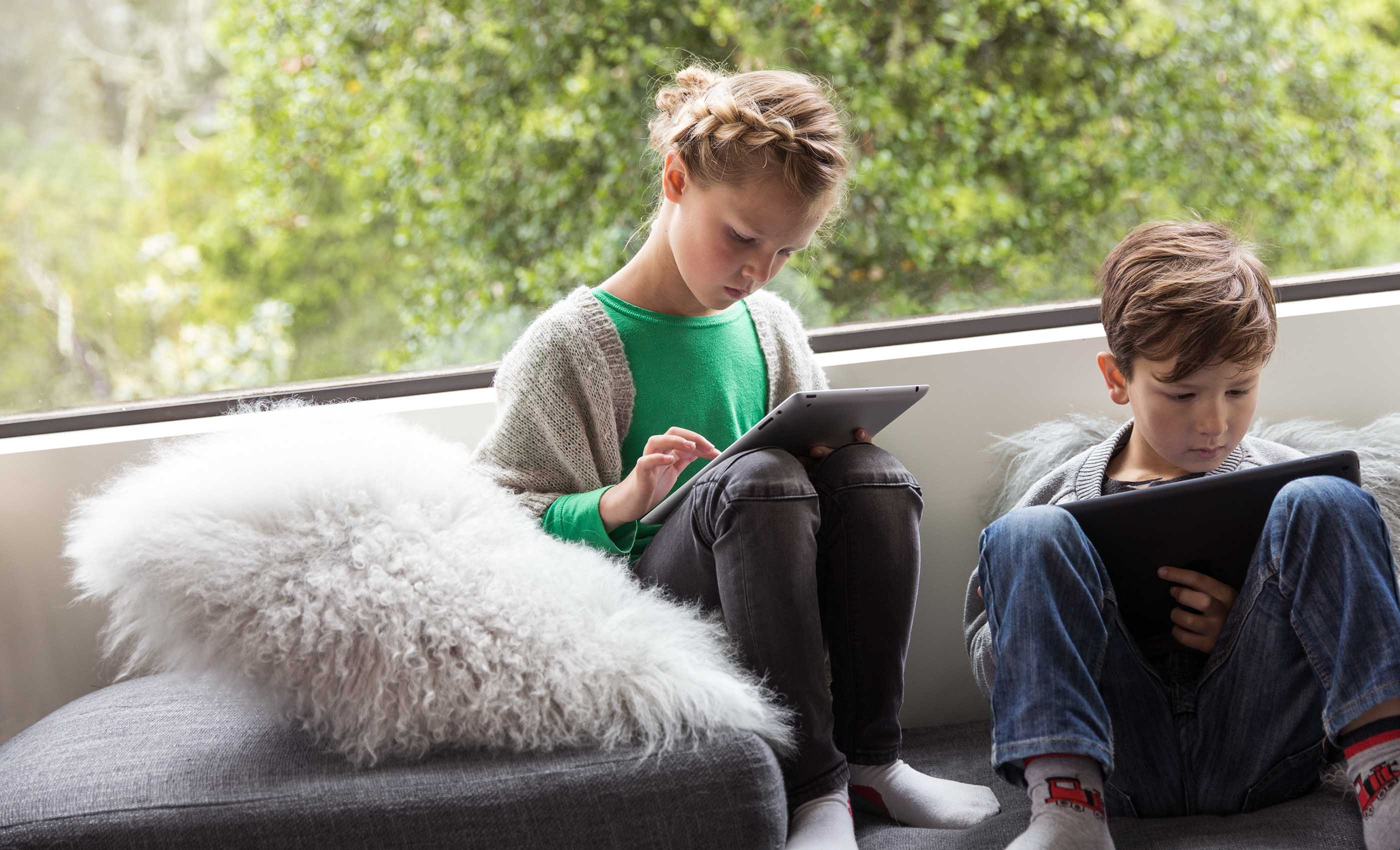 Children using mobile devices - protected by eero Plus